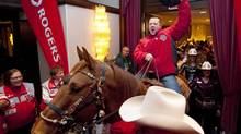 Dallas Mullaney, of the Calgary Grey Cup Committee, rides Kola the horse into the Chateau Lacombe Crowne Plaza hotel in Edmonton on Friday, Nov. 26, 2010. (John Ulan/THE CANADIAN PRESS)