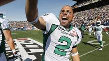 Saskatchewan Roughriders' Sandro DeAngelis (2) celebrates after kicking the winning field goal in the last seconds of the second half of their CFL game in Winnipeg Sunday, September 9, 2012. (John Woods/THE CANADIAN PRESS)