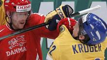 Denmark's Jannik Hansen (L) fights with Sweden's Marcus Kruger during their 2012 IIHF men's ice hockey World Championship game in Stockholm May 7, 2012. REUTERS/Petr Josek (Petr Josek/Reuters)