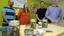 Pete O'Neil, right, stands in his soon-to-be-open medical marijuana dispensary in Seattle with three of his employees on June 23, 2014. O'Neil struck out in Washington's lottery for coveted pot-shop licences, and he has unsuccessfully tried to buy companies who did. In frustration, he's turning what would have been his Seattle retail store into a medical marijuana dispensary. Also pictured are Patricia Barker, second from left, grower representative; Adam Girton, second from right, product line adviser; and John Minehart, managing director of U.S. Cannabis. (TED S. WARREN/ASSOCIATED PRESS)