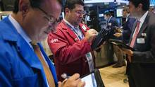Traders work on the floor of the New York Stock Exchange shortly after the markets opening in New York, July 22, 2013. (LUCAS JACKSON/REUTERS)