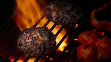 Hamburgers with sundried tomato and cumin grilling on the barbecue. (Stephen Caissie/Stephen Caissie)