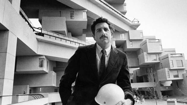 Architect Moshe Safdie sits in front of Habitat 67, one of the exhibits at Expo '67 in Montreal, on April 21, 1967. Habitat 67 finds itself in top spot today, with more than 86,000 votes, in a competition to determine the next Lego architecture set.