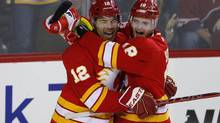 Calgary Flames' Jarome Iginla (L) celebrates his goal with teammate Matt Stajan during the third period of their NHL game against the Phoenix Coyotes in Calgary, Alberta, February 24, 2013. (TODD KOROL/REUTERS)