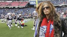 Aerosmith lead singer Steven Tyler stands on the sidelines before singing the U.S. National Anthem prior to the NFL AFC Championship football game between the Baltimore Ravens and the New England Patriots in Foxborough, Massachusetts, January 22, 2012. (MIKE SEGAR/Mike Segar / Reuters)