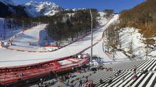 Spectators begin to fill the empty seats ahead of the women's alpine skiing downhill race (KAI PFAFFENBACH/REUTERS)