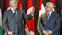 Foreign Minister Lawrence Cannon speaks at a conference with Palestinian president Mahmoud Abbas in Ottawa on May 25, 2009. (CHRIS WATTIE/Reuters)