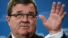 Finance Minister Jim Flaherty holds a press conference in the media lock-up prior to tabling the budget in Ottawa on Feb. 11, 2014. (SEAN KILPATRICK/THE GLOBE AND MAIL)