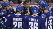 Vancouver Canucks Head coach Alain Vigneault talks to his team during a time out in the third period in game one of the NHL Western Conference semifinal Stanley Cup playoff hockey series in Vancouver April 28, 2011. (JOHN LEHMANN/JOHN LEHMANN/THE GLOBE AND MAIL)