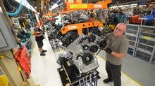 Chrysler employees assemble cars at the assembly plant in Brampton, Ont., in this photo from 2011. (Kevin Van Paassen/The Globe and Mail)