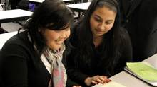 From left: Vancouver Community College International students Mutiara Santoso and Parvinder Kaur in class November 24, 2010 in Vancouver. (Laura Leyshon for the Globe and Mail/Laura Leyshon for the Globe and Mail)