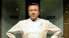 French chef Daniel Boulud poses at the entrance of his flagship restaurant a§aaa¨Daniela§aa¬ù in New York, October 27, 2009. (EMMANUEL DUNAND/AFP/Getty Images)