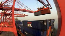 A crane loads containers at a port in Lianyungang, Jiangsu province, China on Jan.10, 2013. (CHINA DAILY/REUTERS)
