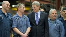 Prime Minister Stephen Harper mingles with workers during a campaign stop at a steel plant in Brampton, Ont., on March 17, 2011. (Kevin Van Paassen/Kevin Van Paassen/The Globe and Mail)