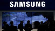 Visitors walk past the Samsung area at the GSMA Mobile World Congress in Barcelona, in this file picture taken February 14, 2011. (ALBERT GEA/REUTERS)