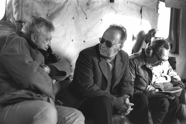 Mr. Peres, right, then the defence minister, sits next to prime minister Yitzhak Rabin, middle, and security adviser Ariel Sharon, left, on a military helicopter flight in 1975.