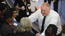 Toronto Mayor Rob Ford meets and greets youth from the Trinity Theatre who were sitting in the public gallery in Toronto city hall council chambers on July 8 2014. (Fred Lum/The Globe and Mail)