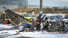 A small plane crash at the foot of the Vancouver International airport in Richmond, B.C. October 27, 2011. (JOHN LEHMANN/JOHN LEHMANN/THE GLOBE AND MAIL)