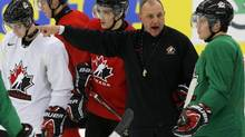 Canada's head coach Brent Sutter directs his team's practice (ALEXANDER DEMIANCHUK/REUTERS)
