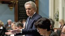 Quebec Premier Jean Charest responds to Oppositoin questions on an expected emergency law on tuition hikes as Education Minister Michelle Courchesne, sits nearby during Question Period on May 17, 2012 at the legislature in Quebec City. (Jacques Boissinot/Jacques Boissinot/The Canadian Press)