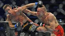 Georges St-Pierre grapples with Jake Shields in a welterweight Ulitimate Fighting Championship title bout in Toronto on April 30, 2011. (Fred Lum/The Globe and Mail)