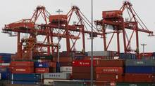 Cargo containers are stacked up at the Port of Vancouver in Vancouver in this file photo. (DARRYL DYCK/THE CANADIAN PRESS)