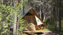 Don't want to sleep on the ground but still like the outdoors? Book these tent-like cabins.