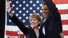 U.S. President Barack Obama and Massachusetts Senate candidate Martha Coakley wave during a campaign rally at Northeastern University in Boston. (SAUL LOEB)