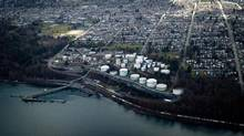Kinder Morgan's Westridge Marine Terminal is pictured in Burnaby, B.C., on Wednesday February 19, 2014. The company is arguing for a narrow interpretation of who can take part in a review of its Trans Mountain pipeline project. (DARRYL DYCK/THE CANADIAN PRESS)