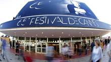 People walk past the Festival Palace in Cannes on May 15, 2012. The Cannes Film Festival runs from May 16 to 27. (Reuters)