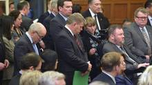 Members of Parliament reflect as Prime Minister Stephen Harper speaks announcing former Finance Minister Jim Flaherty had died Thursday April 10, 2014 in Ottawa. (Adrian Wyld/THE CANADIAN PRESS)