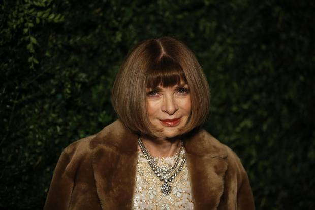 Editor-in-chief of American Vogue Anna Wintour poses on the red carpet as she attends the 60th London Evening Standard Theatre Awards 2014 in London on November 30, 2014.