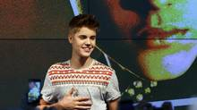 Justin Bieber performs at an exclusive acoustic concert in Frankfurt on Sept. 11, 2012. (Mario Vedder/AP)