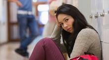 Student in a hallway (Thinkstock)