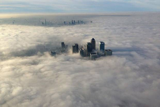 The buildings of London's Canary Wharf financial district rise above the morning fog. Resentment of the liberal establishment embodied by London – which, unlike the rest of England, largely voted Remain – helped to widen the cultural divide that made Brexit possible.
