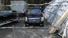The black Cadillac Escalade owned by Toronto Mayor Rob Ford sits in the impound lot at Northland Towing & Recovery in Gravenhurst, Ont., May 22, 2014. An Ontario Provincial Police statement said that 36-year-old Lee Anne McRobb of Muskoka Lakes Township is facing charges of impaired driving and driving with more than 80 milligrams of alcohol per 100 millilitres of blood after Bracebridge officers stopped her in a black Cadillac Escalade. (J.P. Moczulski for The Globe and Mail) (J.P. MOCZULSKI FOR THE GLOBE AND MAIL)