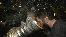 Los Angeles Kings' Rob Scuderi (7) celebrates with the Stanley Cup in the locker room after the Los Angeles Kings defeated the New Jersey Devils 6-1 in Game Six of the 2012 Stanley Cup Final at the Staples Center in Los Angeles, California June 11, 2012. (POOL/REUTERS)