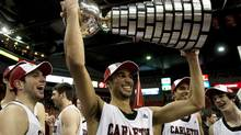 Carleton Ravens Philip Scrubb, tournament MVP, raises the W. P. McGee trophy after defeating the University of Alberta Golden Bears 86-67 in the CIS Final 8 men's basketball championship game in Halifax on Sunday, March 11, 2012. THE CANADIAN PRESS/Andrew Vaughan (Andrew Vaughan/CP)