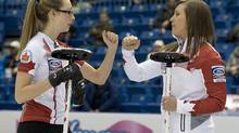 Canada skip Rachel Homan (right) and second Alison Kreviazuk tap fists as they play China at the Ford World Women's Curling Championships in Saint John, N.B. on Thursday, March 20, 2014. Kreviazuk is leaving the team at the end of the season in order to move to Sweden to be with her boyfriend. (Andrew Vaughan/THE CANADIAN PRESS)