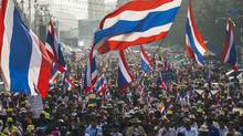 Anti-government protesters march during a rally in central Bangkok January 7, 2014. Celebrities and the intelligentsia have banded together to stop what they see as a corrupt political dynasty. (ATHIT PERAWONGMETHA/REUTERS)