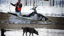 One of the damaged snowmobiles damaged in a weekend avalanche is retrieved on March 14, 2010 near Revelstoke, B.C. (JOHN LEHMANN/John Lehmann/The Globe and Mail)