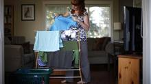 Air drying her laundry helped Denise McGeachy in the early years of the Power Smart program to cut power usage by more than 10 per cent. (CHAD HIPOLITO PHOTOS FOR THE GLOBE AND MAIL)