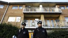 """Police stand guard in front of a property in Lambeth, south London Nov. 23, 2013. Three women enslaved in London for 30 years appeared to have been part of a cult and bound to their captors by """"invisible handcuffs"""" through beatings and brainwashing, police said on Saturday. (LUKE MACGREGOR/REUTERS)"""