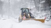 A plough clears snow as Toronto is gripped by a winter storm on Friday February 8, 2013. (Chris Young For The Globe and Mail)