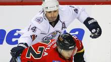 Edmonton Oilers defenceman Sheldon Souray (44) tries to slow down Calgary Flames captain Jarome Iginla during the third period of their NHL hockey game in Calgary, Alberta, April 11, 2009. REUTERS/Todd Korol (Todd Korol)