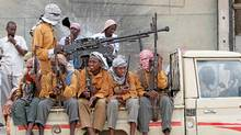 Members of Somalia's hardline al Shabaab rebel group ride on a pick-up truck after attending Eid al-Adha prayers inside a football stadium north of the capital Mogadishu November 16, 2010. (Feisal Omar/Reuters/Feisal Omar/Reuters)