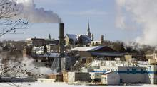 Smoke rises from the Abitibi-Consolidated mill in Shawinigan, Que. on Jan. 29, 2007. With global climate-change talks in limbo, Quebec says it's going ahead with a cap-and-trade program. (PAUL CHIASSON/THE CANADIAN PRESS)