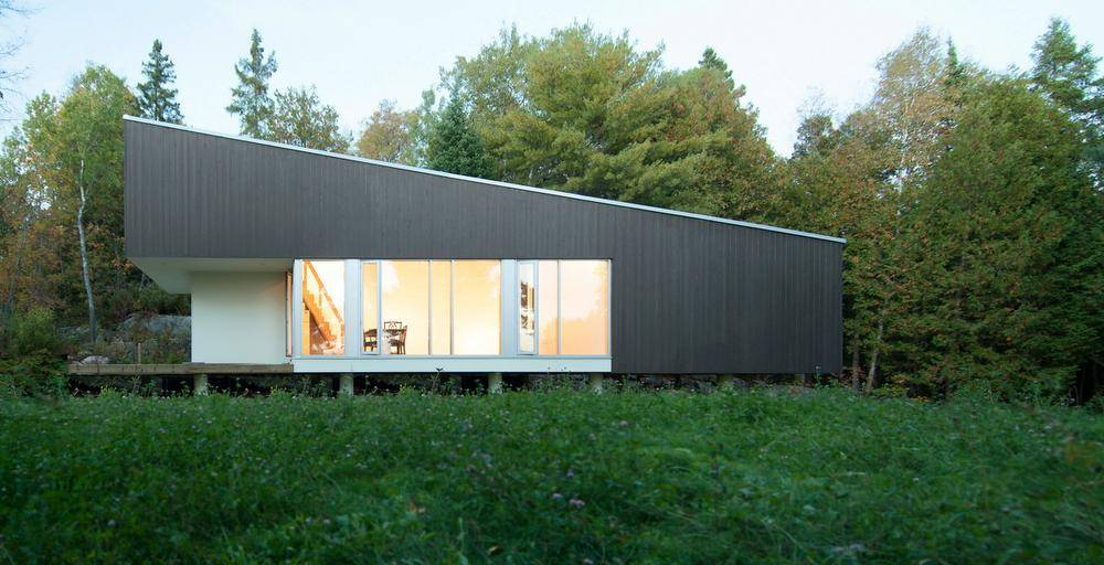 A modern cottage, like a wedge in the wilderness - The ...