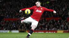 Manchester United's Wayne Rooney lines up a shot during his team's 's English Premier League soccer match against Wigan at Old Trafford Stadium, Manchester, England, Monday Dec. 26, 2011. (JON SUPER/Reuters)