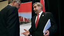 CP Rail chairman John Cleghorn, left, and CEO Fred Green at the company's annual general meeting May 9, 2008, in Winnipeg. Activist investor Bill Ackman wants Mr. Green replaced as CEO by archrival Hunter Harrison, formerly of CN Rail. (John Woods/The Canadian Press/John Woods/The Canadian Press)